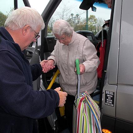driver helping a passenger